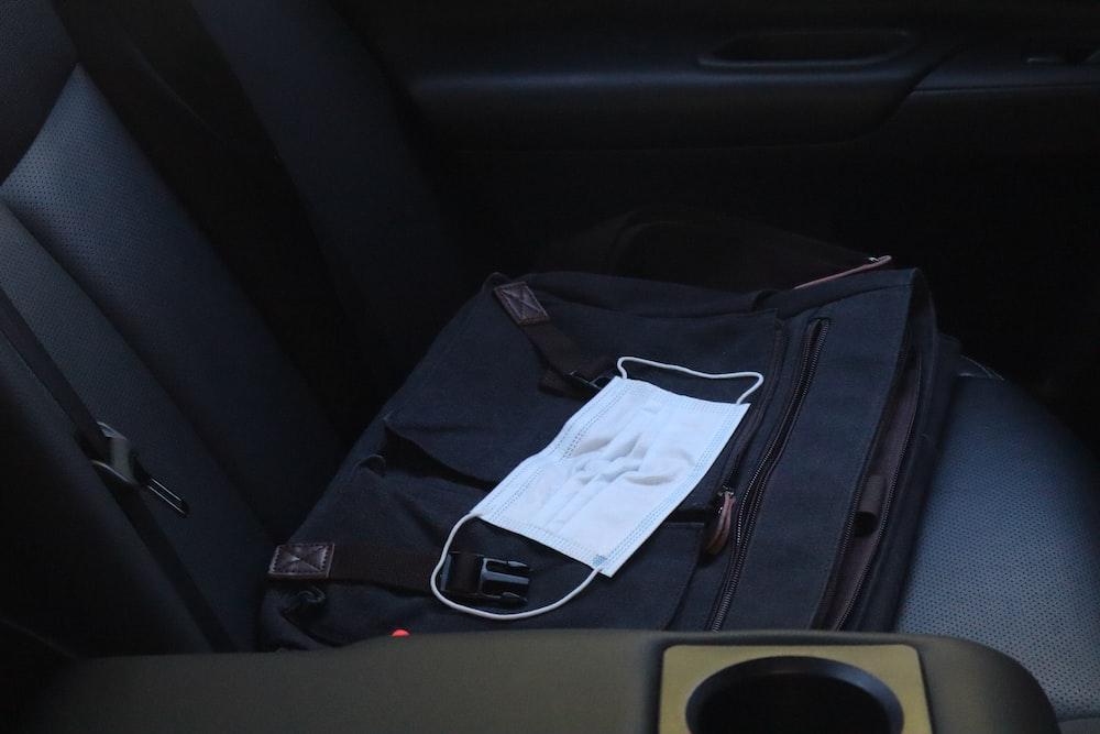 white paper on black bag