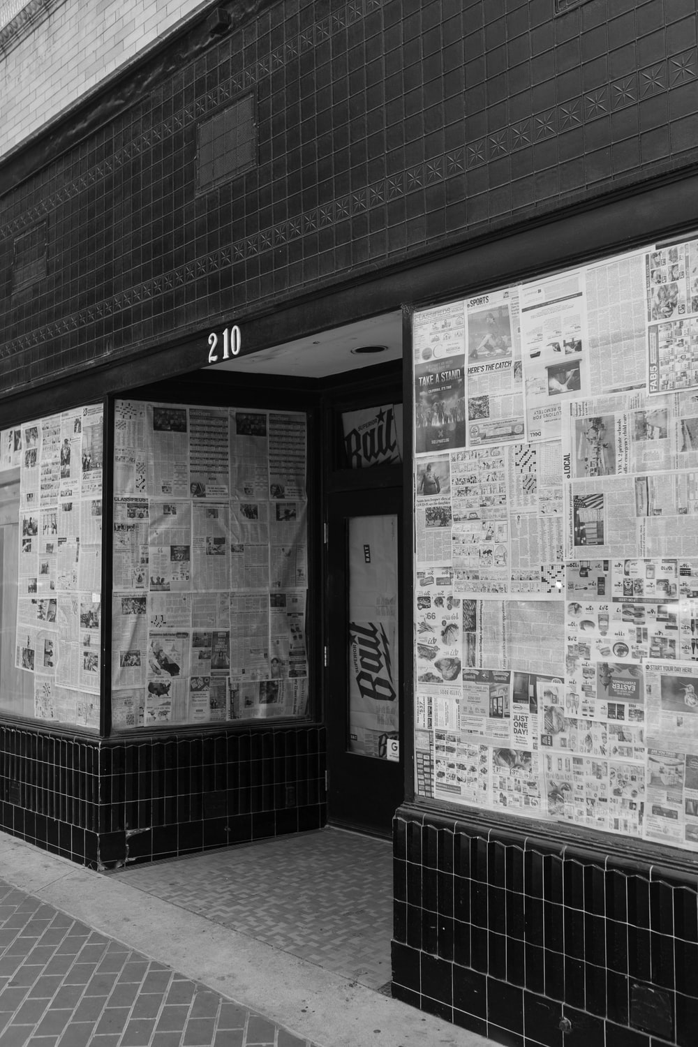 grayscale photo of a store