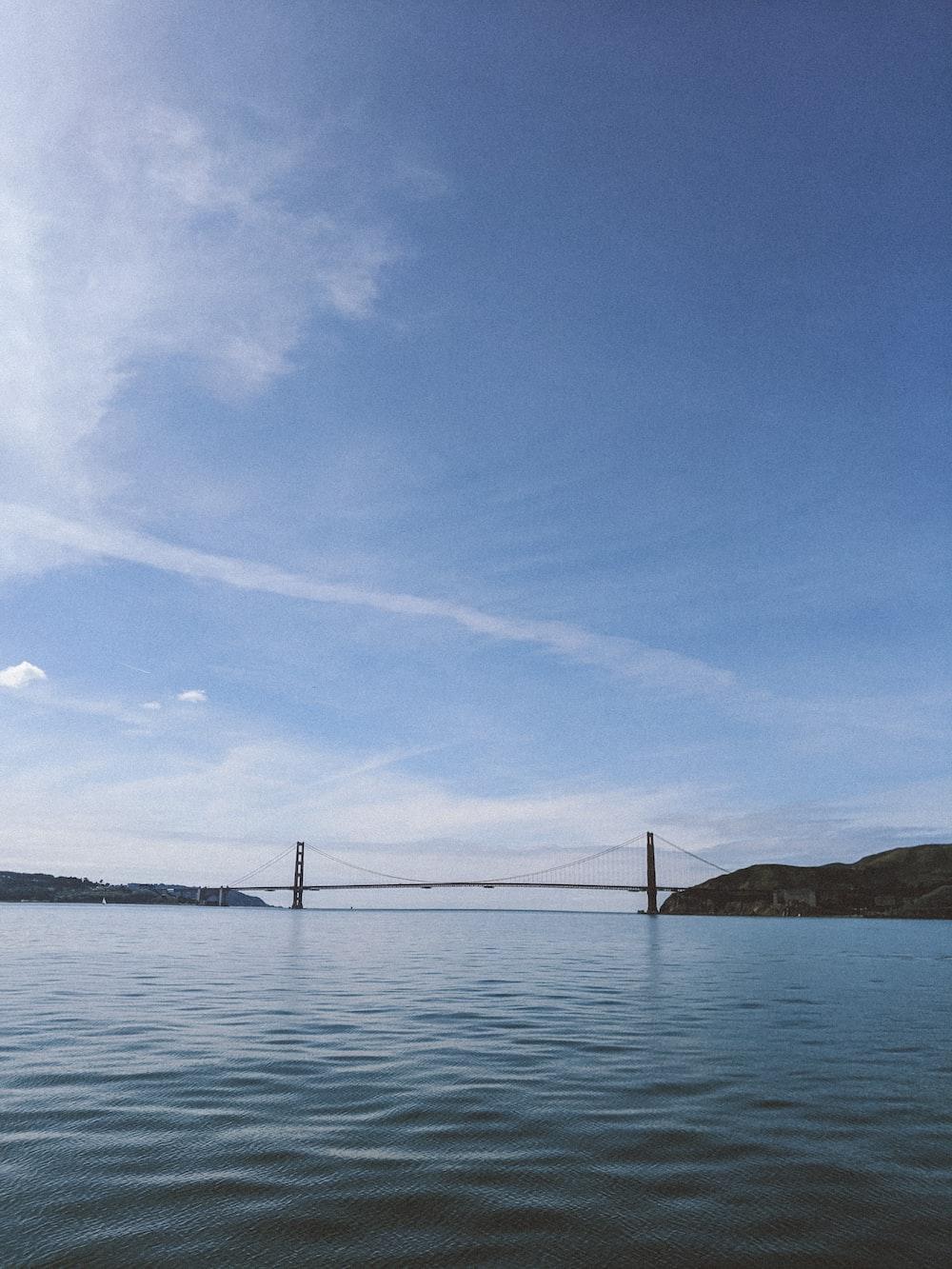 bridge over the sea under blue sky