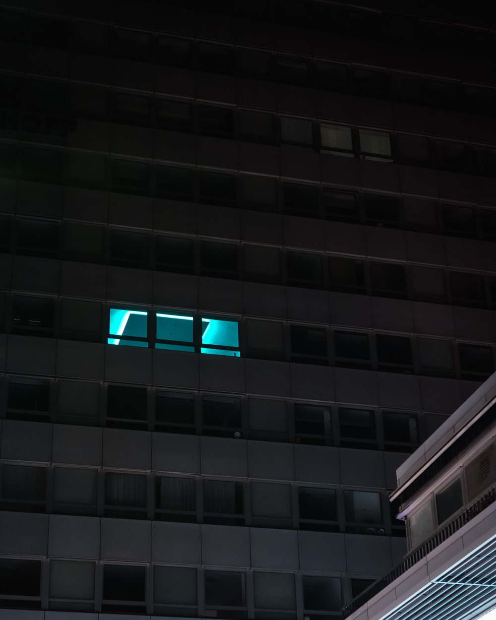 gray concrete building with blue light