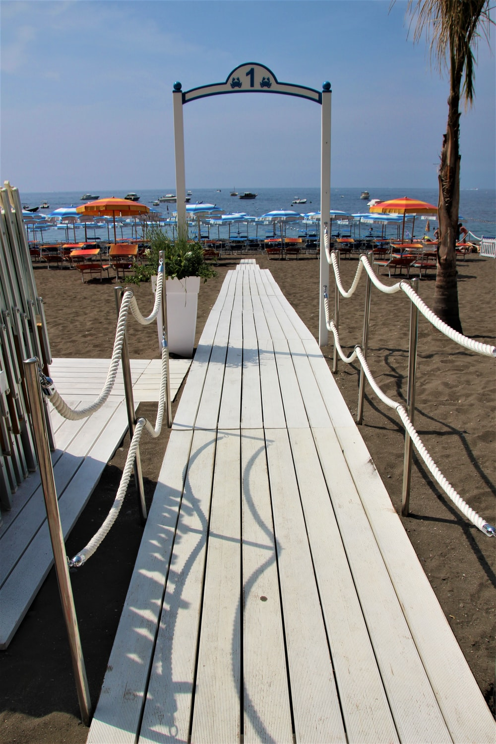 white wooden dock near body of water during daytime