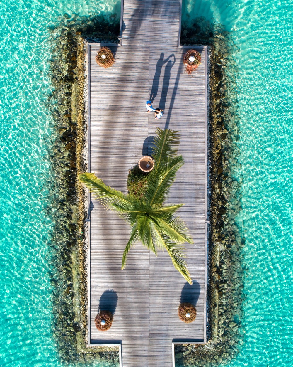 aerial view of 2 people in beach during daytime