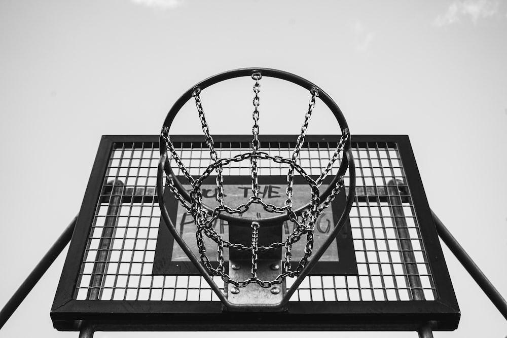 grayscale photo of basketball hoop