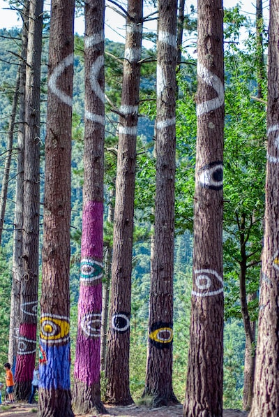 Purple and white floral textile - Omako basoa - Oma Forest detail - Eyes painted over trees