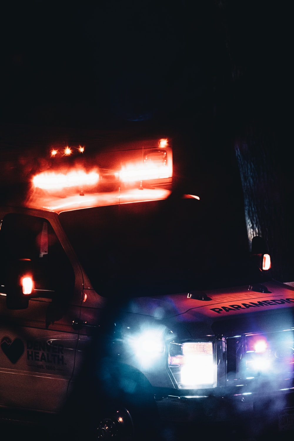 white truck with red light