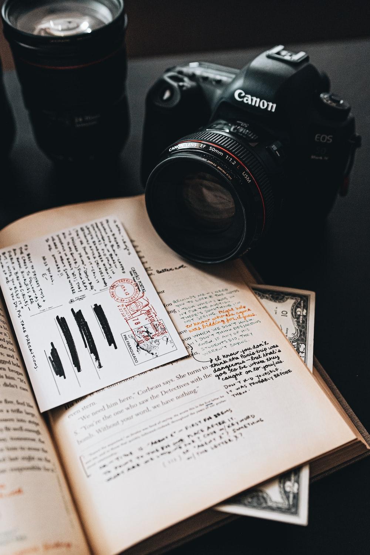 black nikon dslr camera on white book page