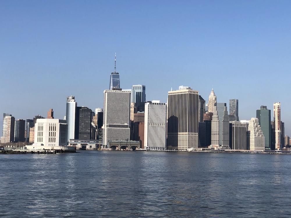 city skyline under blue sky during daytime