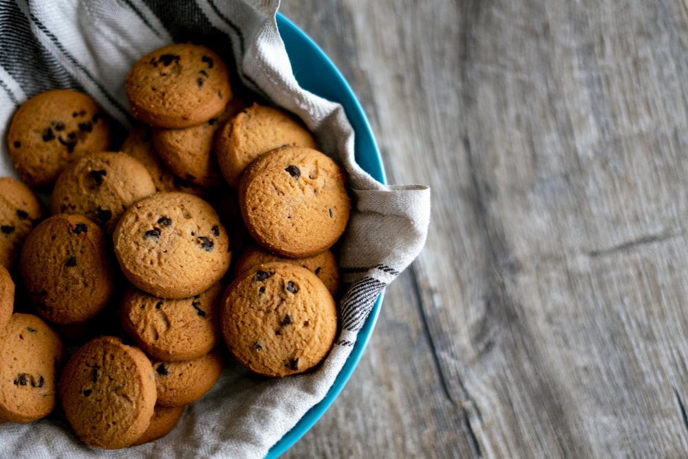 brown cookies in blue ceramic bowl