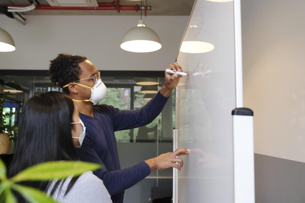 Designers identifying features of design through brainstorming