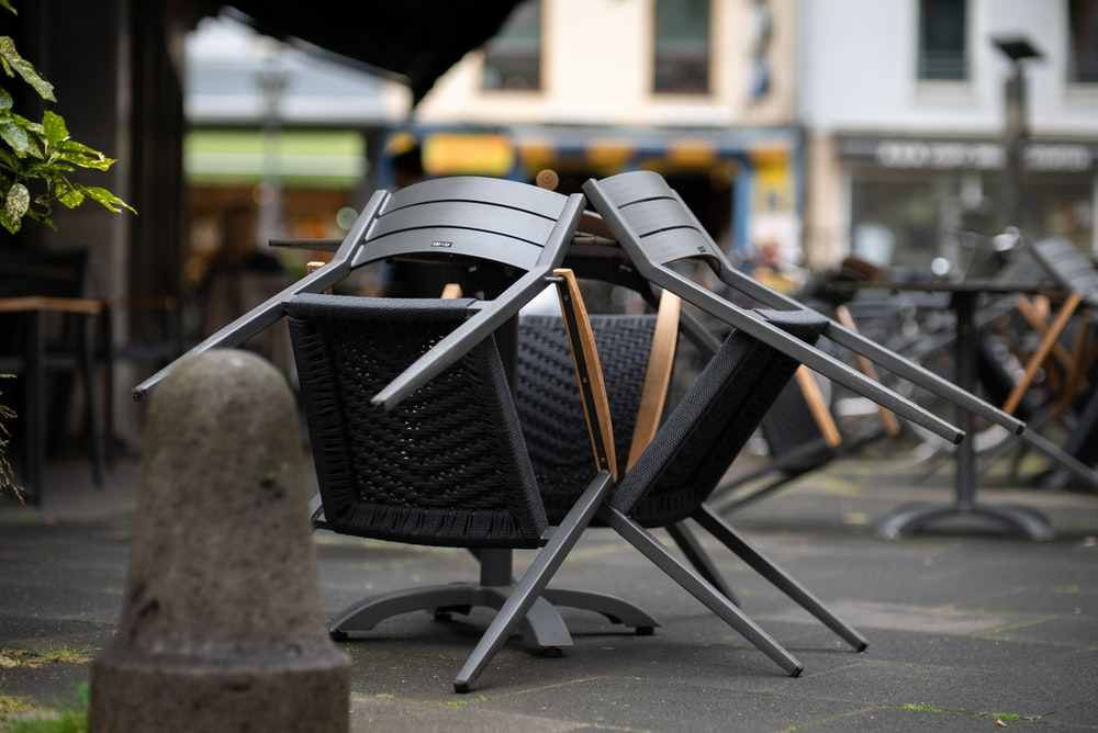 black and brown steel armchairs