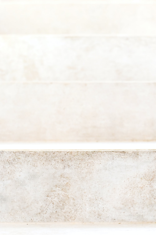 white wall tiles beside white wall