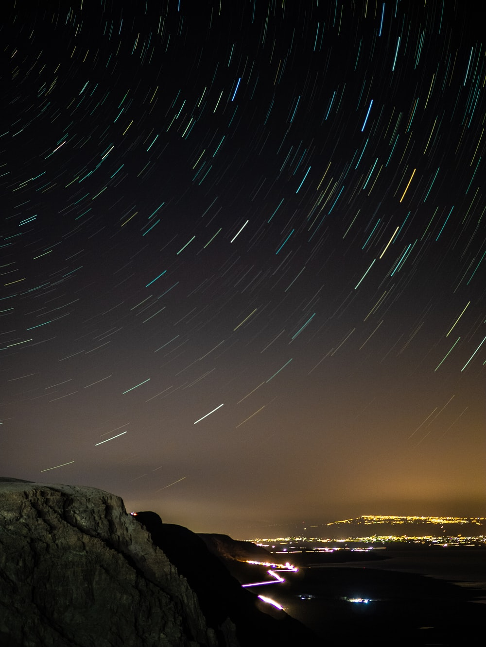 time lapse photography of stars above the sky during night time