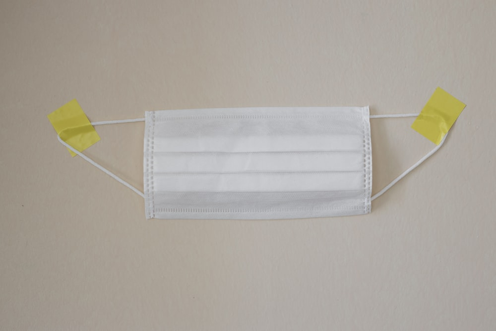 white towel on yellow clothes hanger