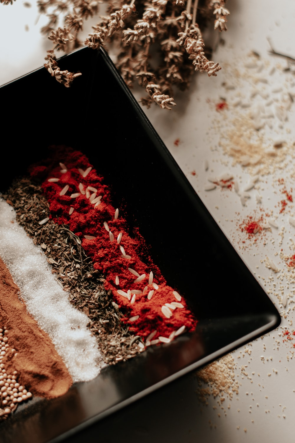 red powder in black container