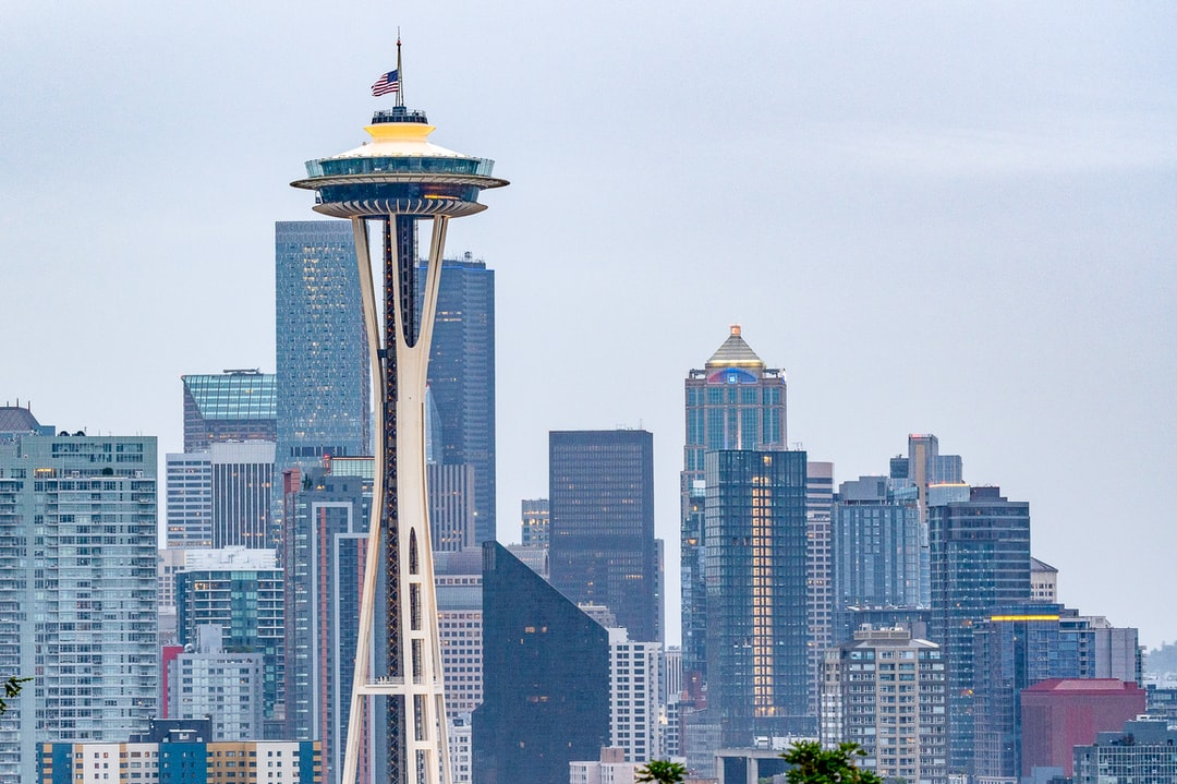 Picture of the Space Needle with the US Flag flying at half-staff, on Memorial Day 2020 with the city of Seattle visible. Taken shortly after sunrise on May 25, 2020. Seattle prepares to honor fallen soldiers in a unique way, due to social distancing.