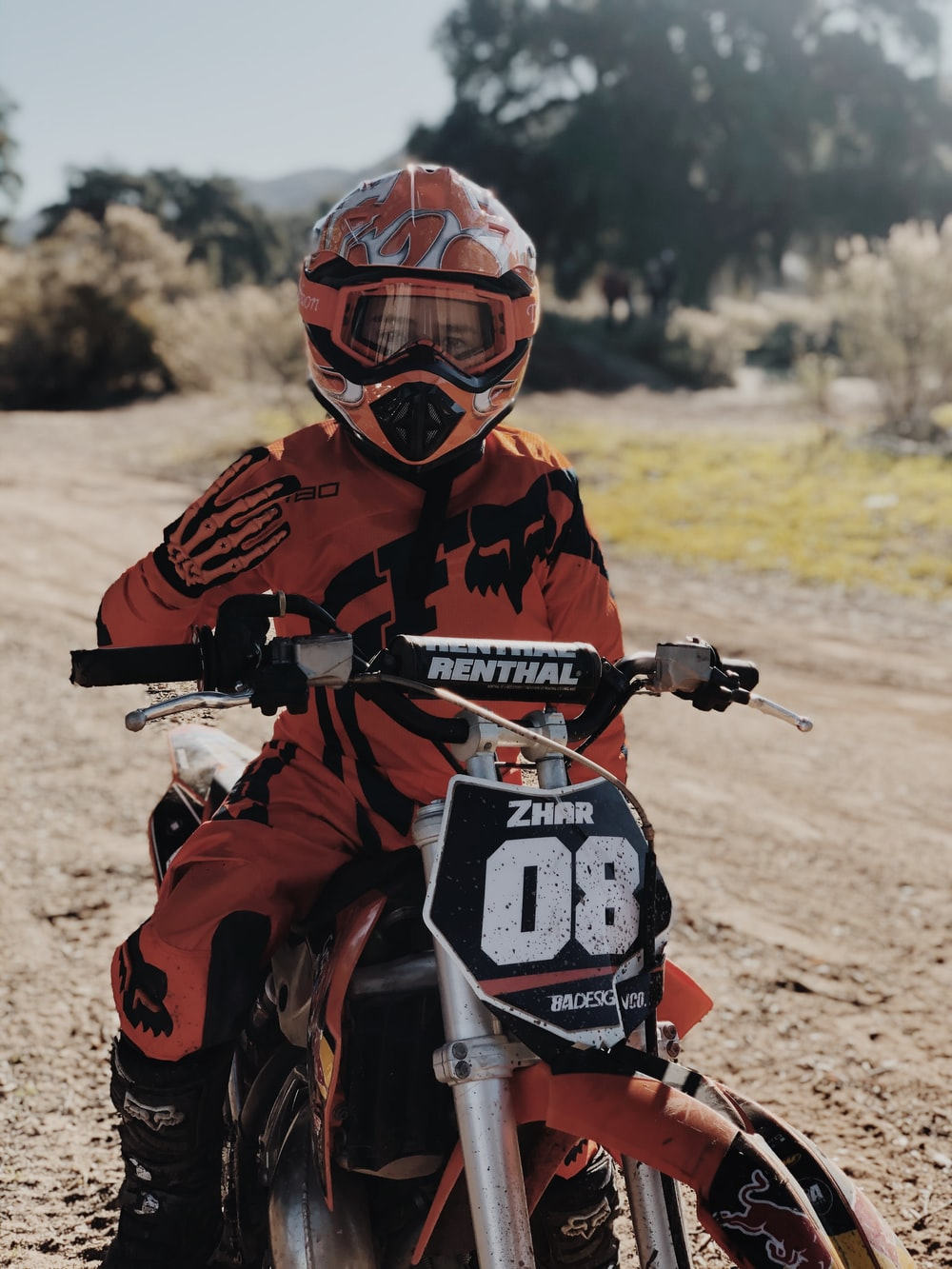 man in orange and black motocross suit riding motocross dirt bike