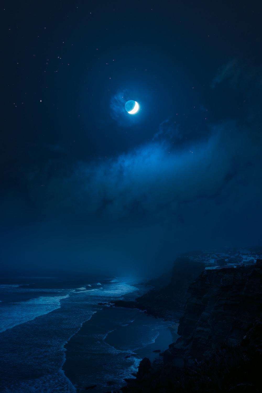 rocky shore under full moon