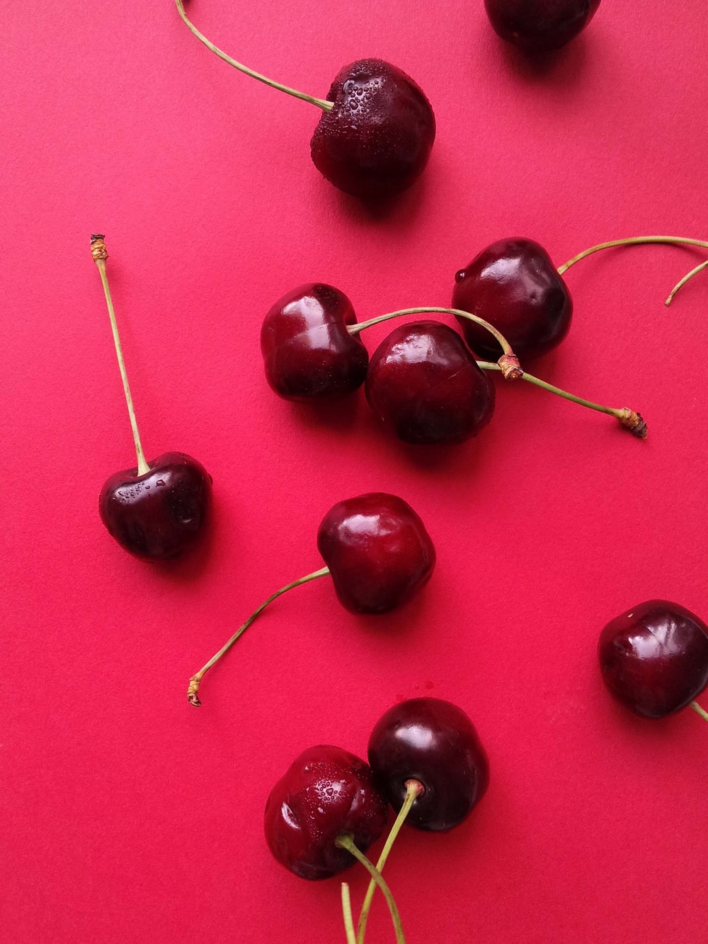 red cherries on red textile
