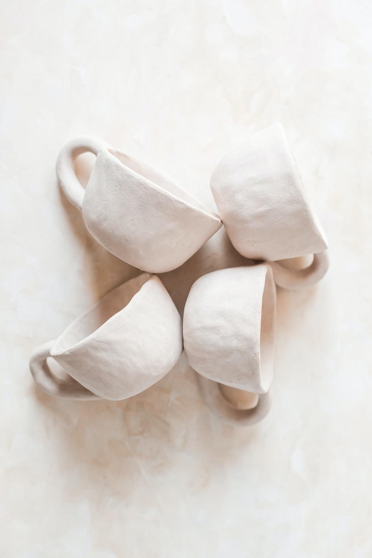 white heart shaped ceramic mug