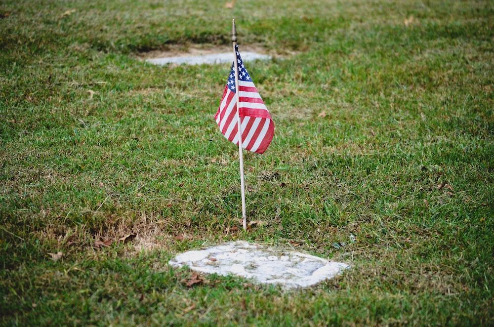 us a flag on gray concrete