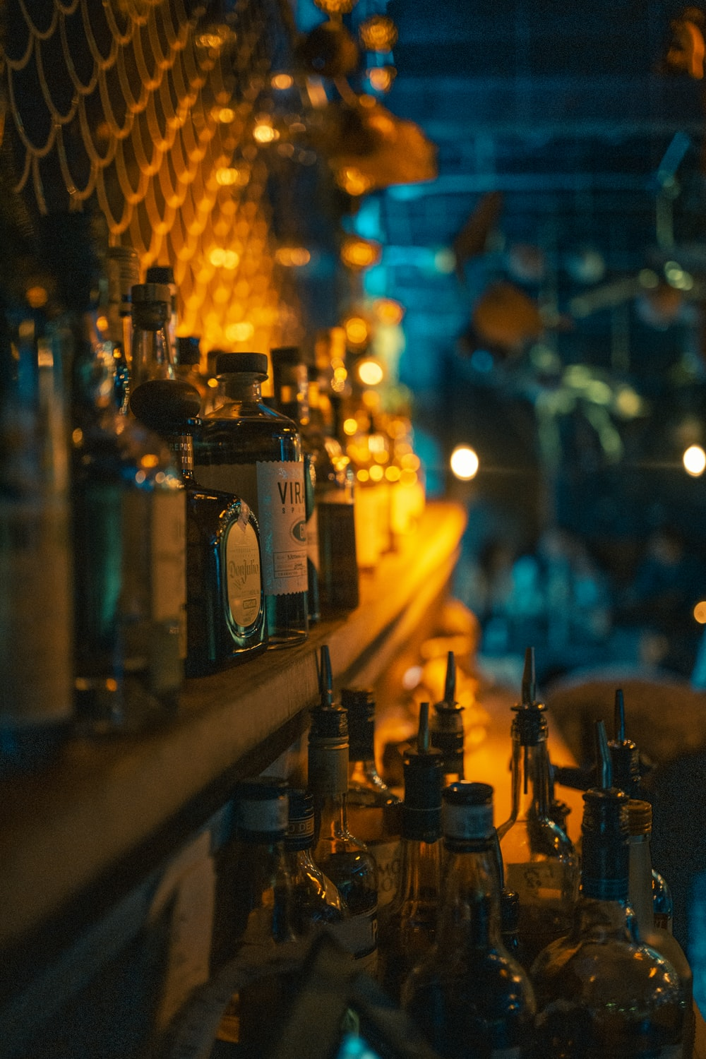 selective focus photography of glass bottles on table