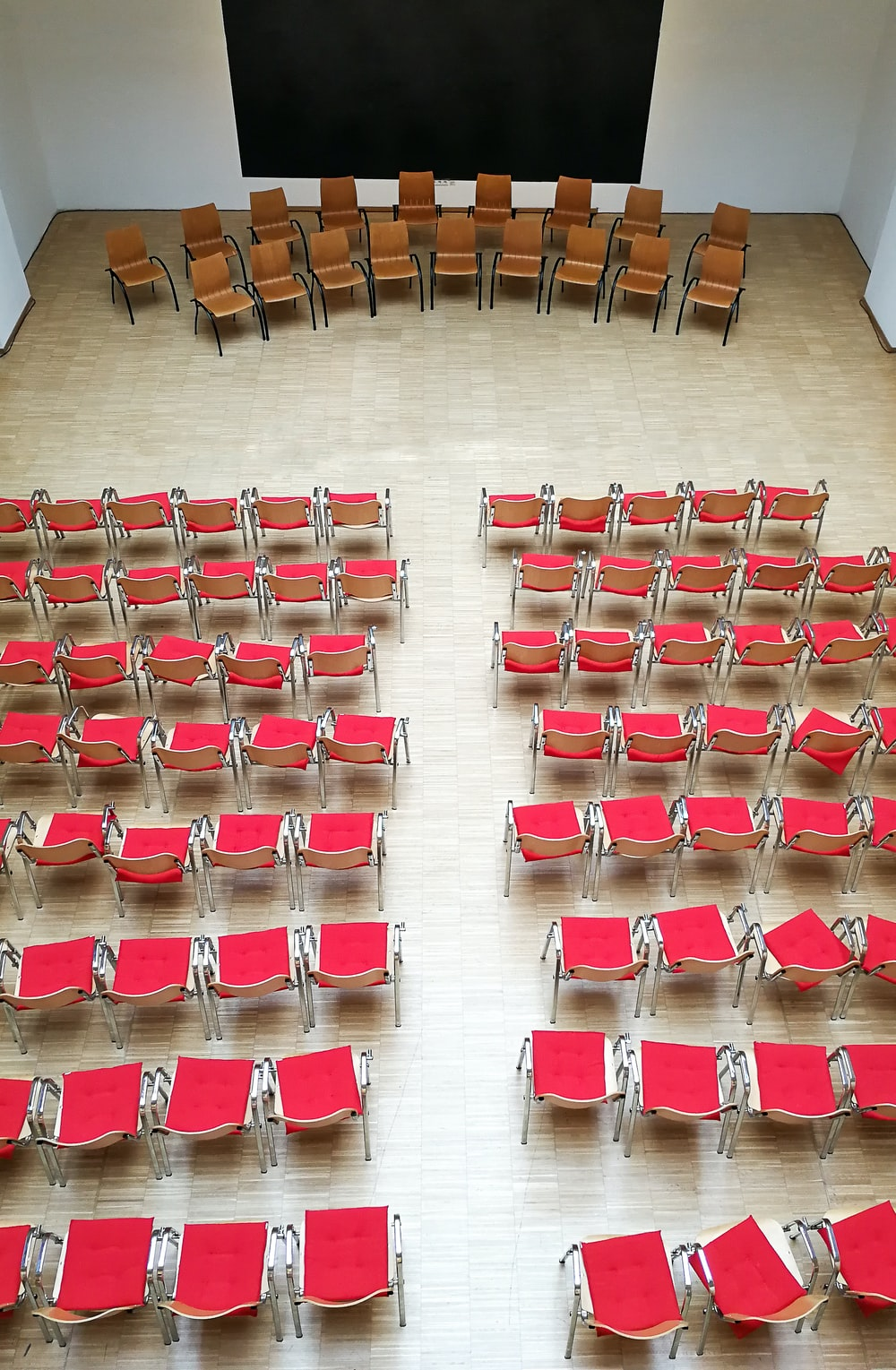 red and white plastic chairs on brown wooden floor
