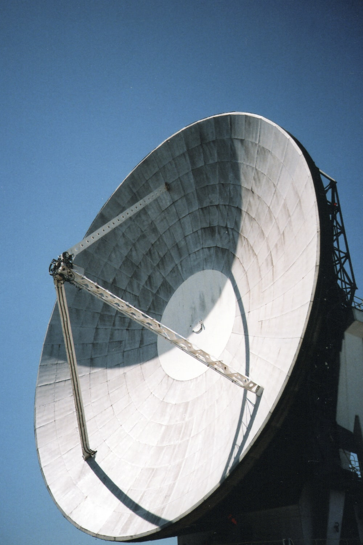 white satellite dish under blue sky during daytime