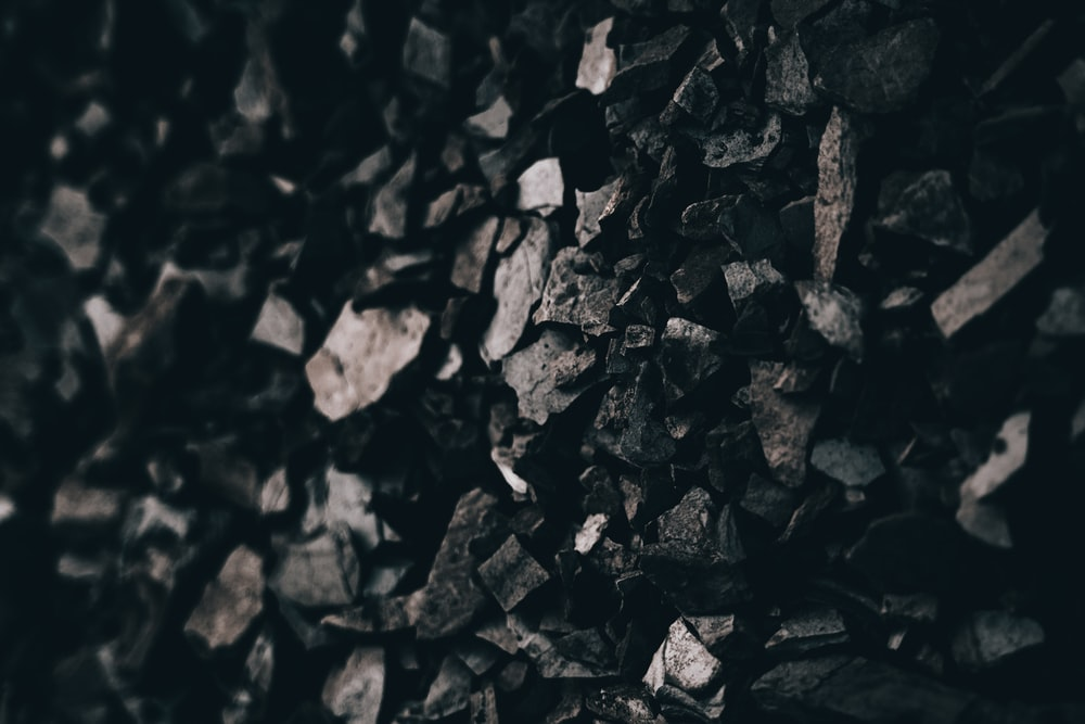 grayscale photo of pile of rocks