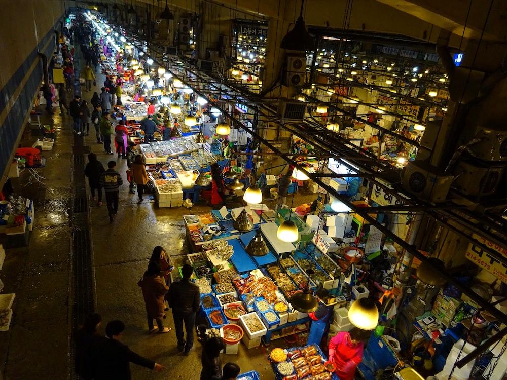 people walking on market during night time