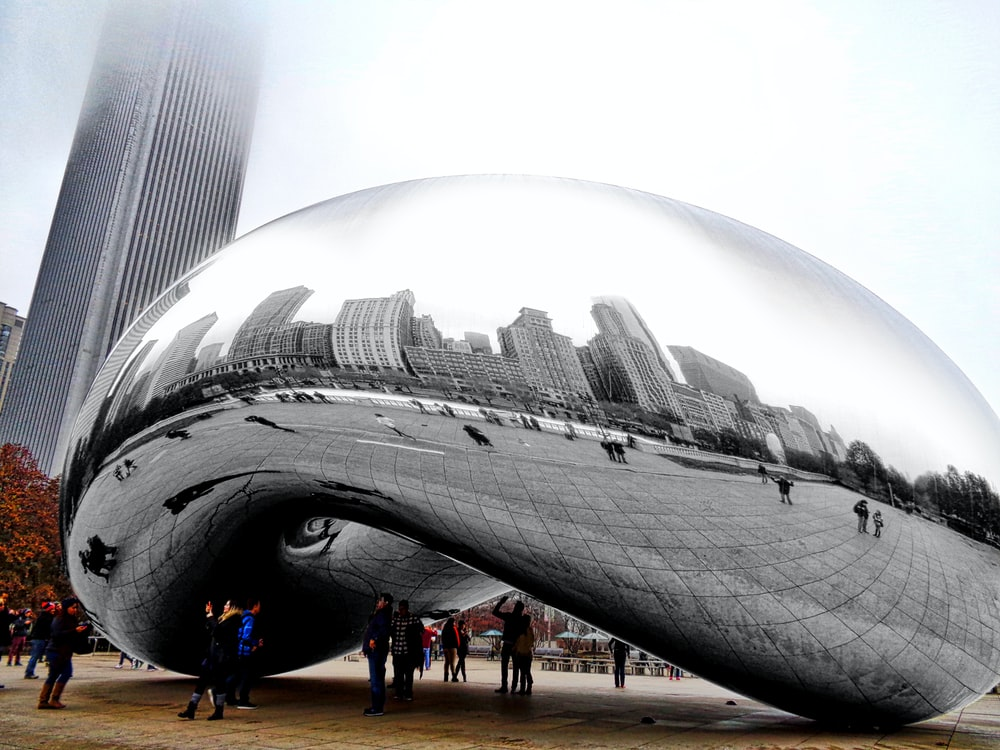 people walking near cloud gate chicago during daytime