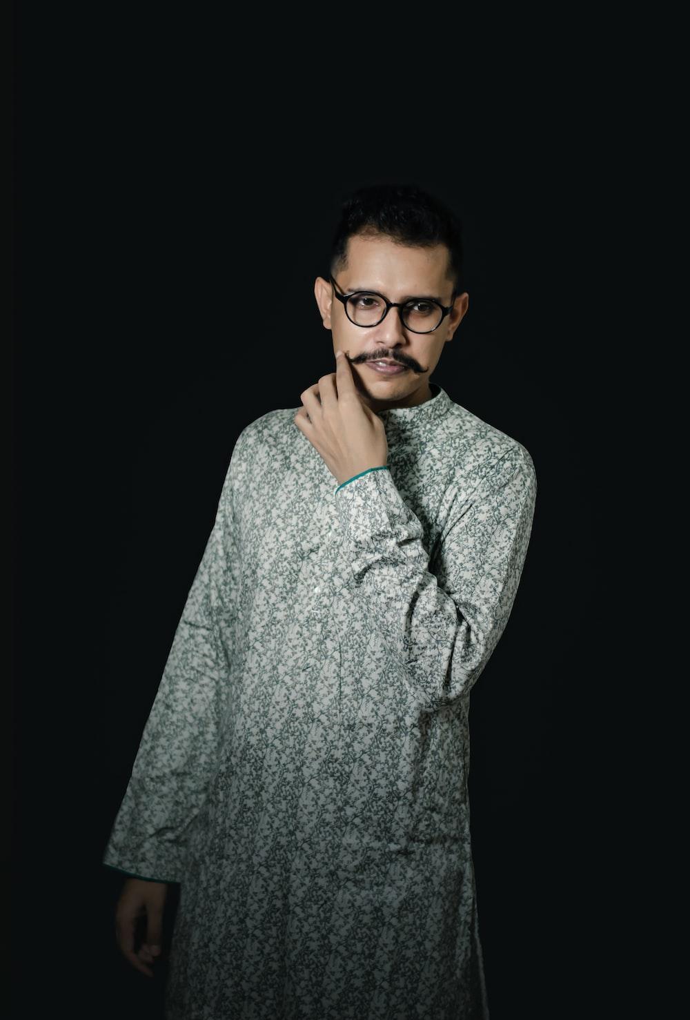 man in gray sweater wearing black framed eyeglasses