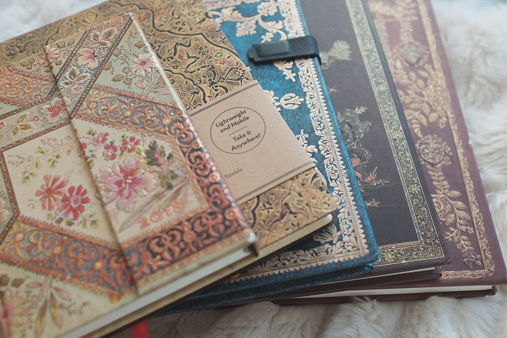 white and blue floral book