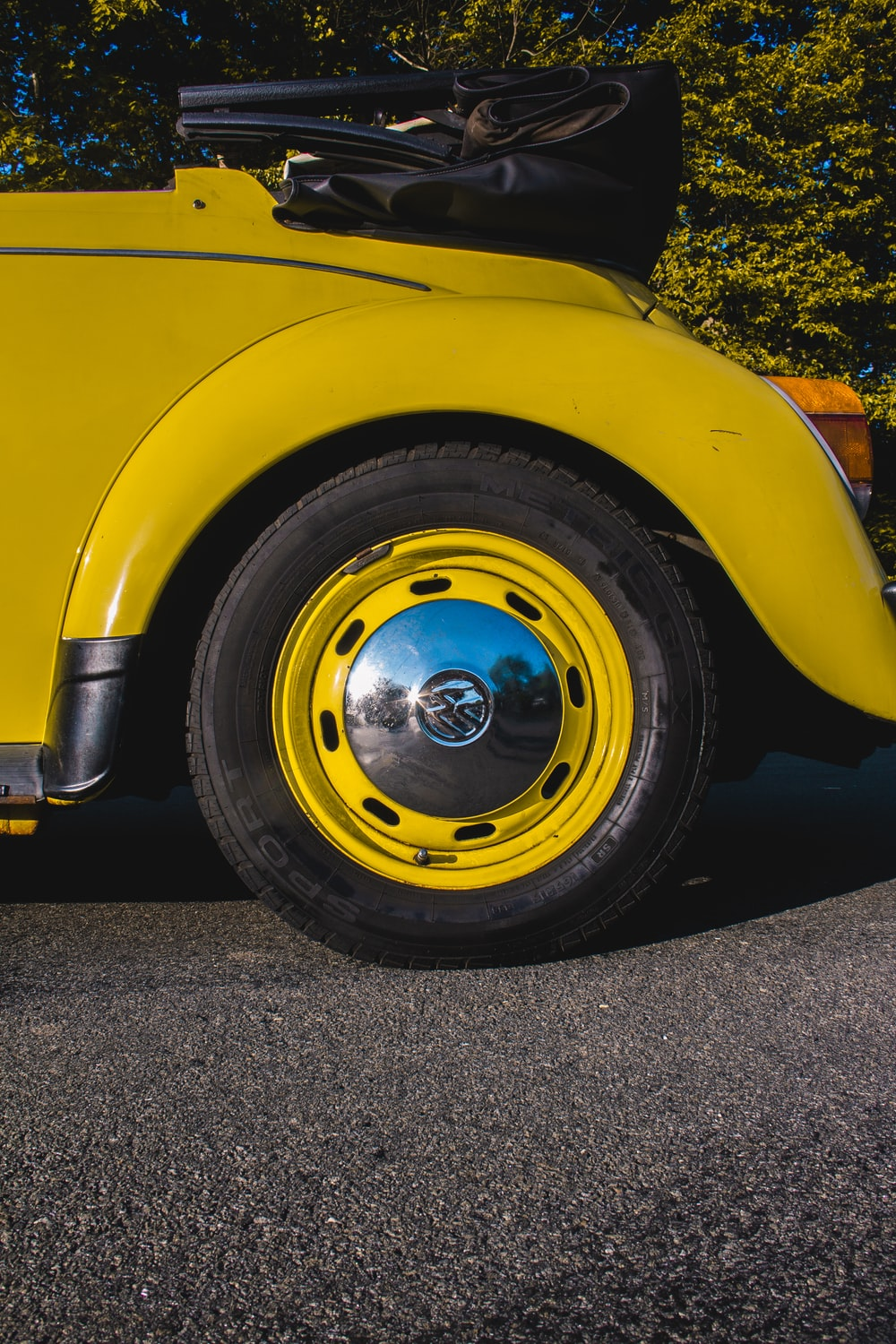 yellow car with gray wheel and tire