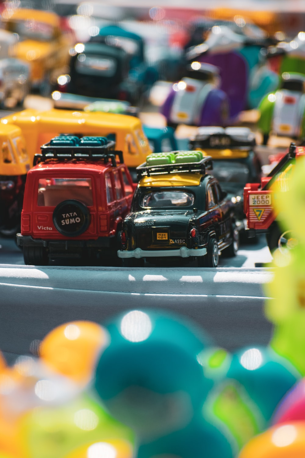 red and yellow car scale model