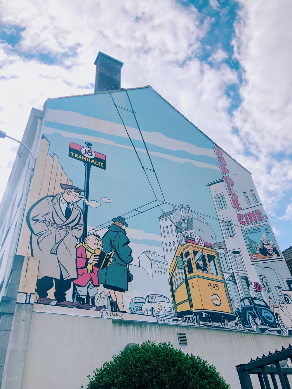 man and woman standing on top of building painting