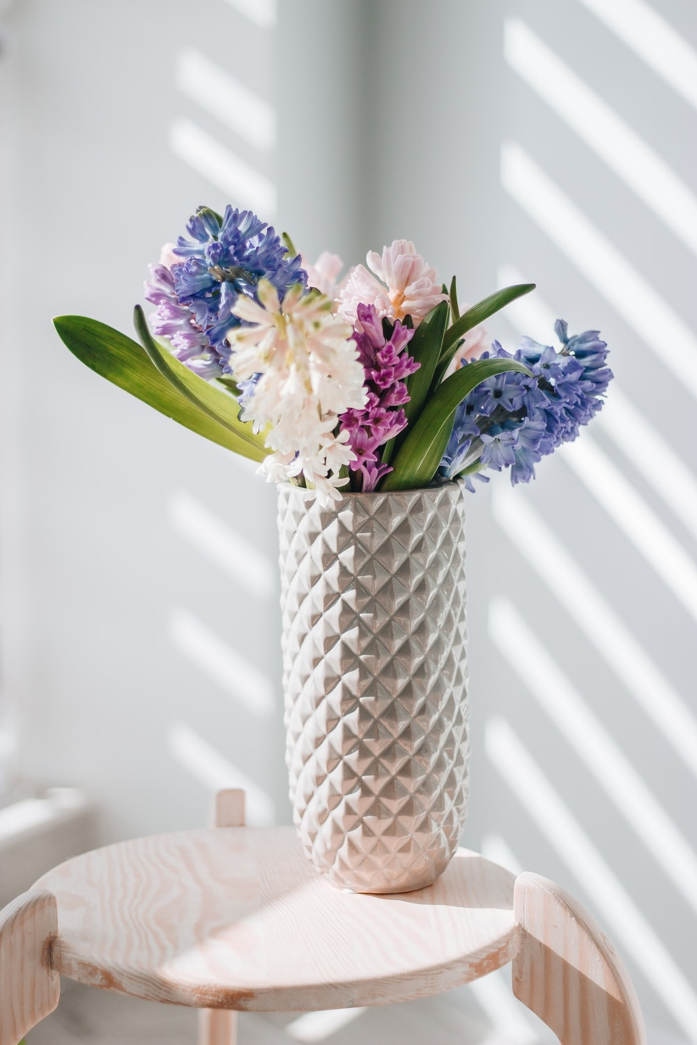 blue and white flowers in clear glass vase