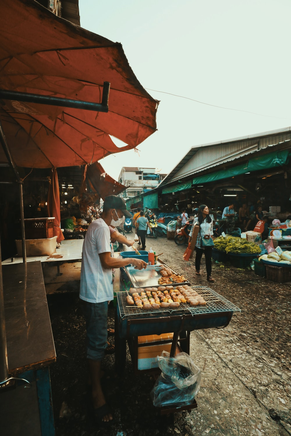 people standing in front of food stall during daytime