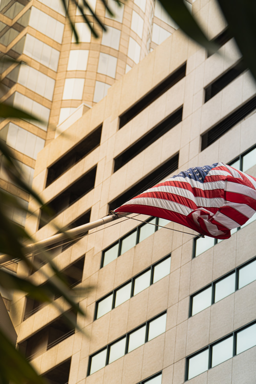 us a flag on brown concrete building