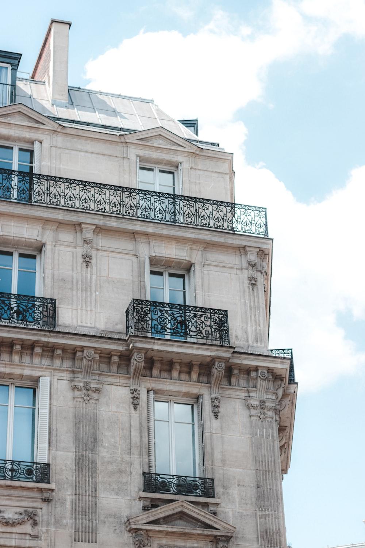 beige concrete building with blue window
