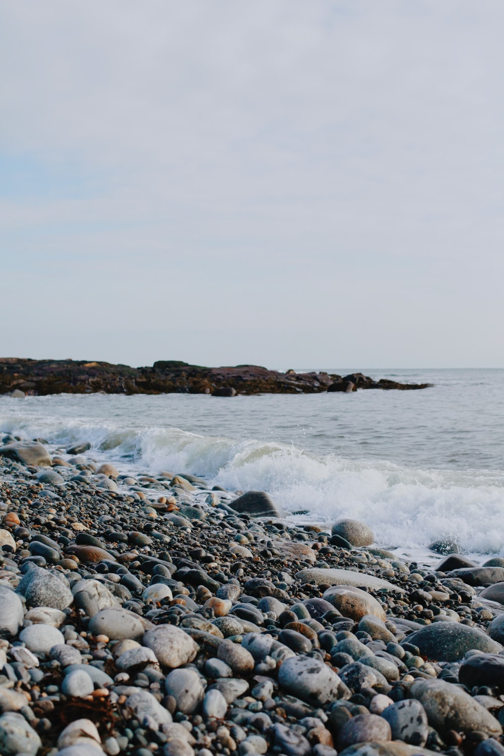 rocky shore with rocky shore during daytime