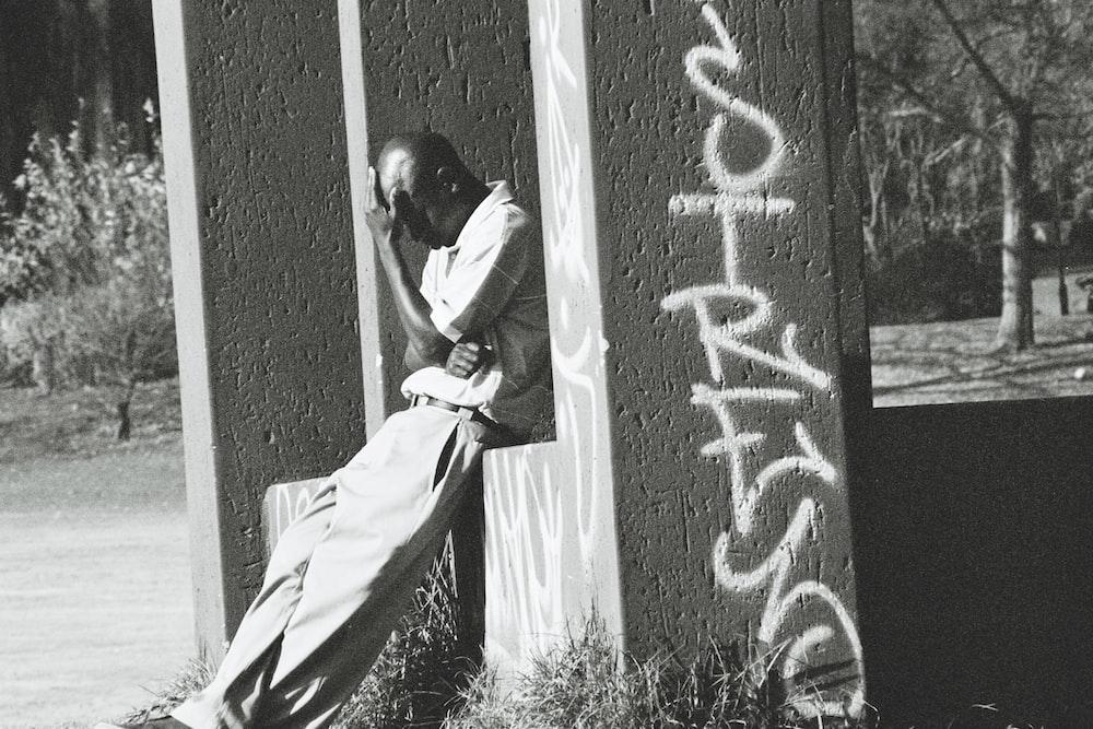 man in white long sleeve shirt hugging woman in white dress