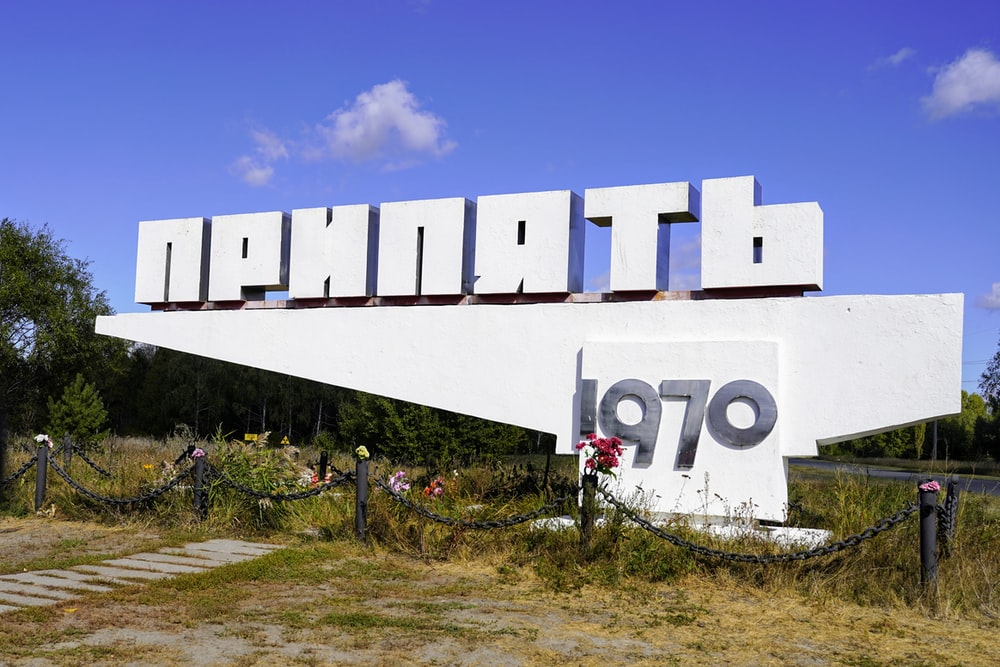 white concrete building with number 8 sign