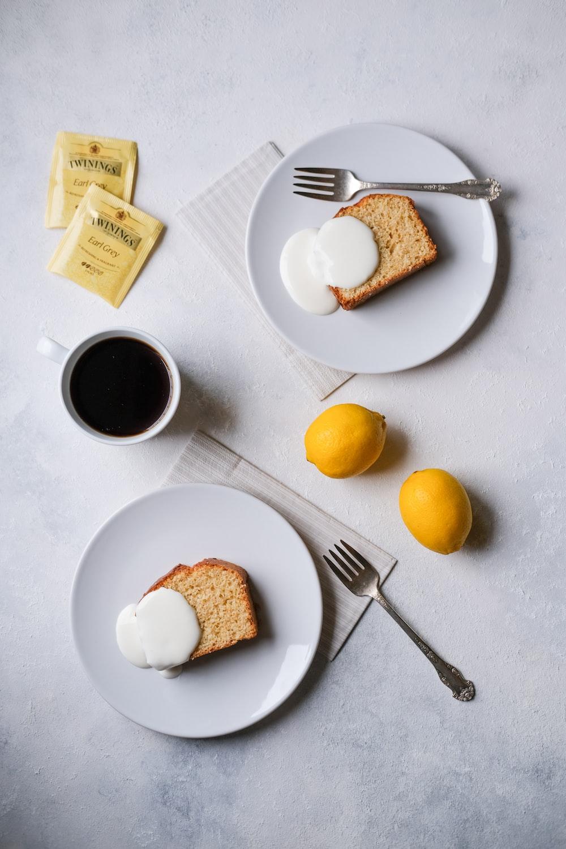 sliced bread on white ceramic plate beside stainless steel fork and knife
