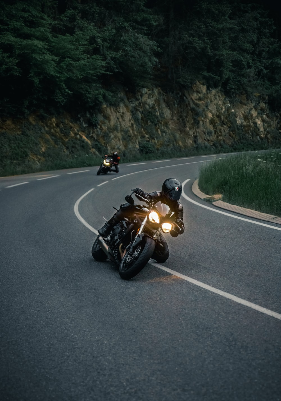 black sports bike on road during daytime