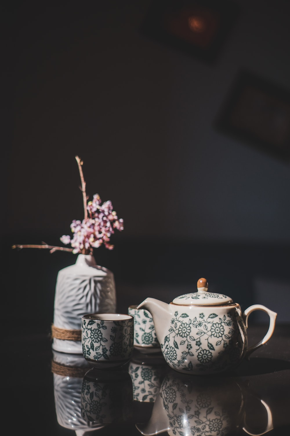 white and blue floral ceramic teapot