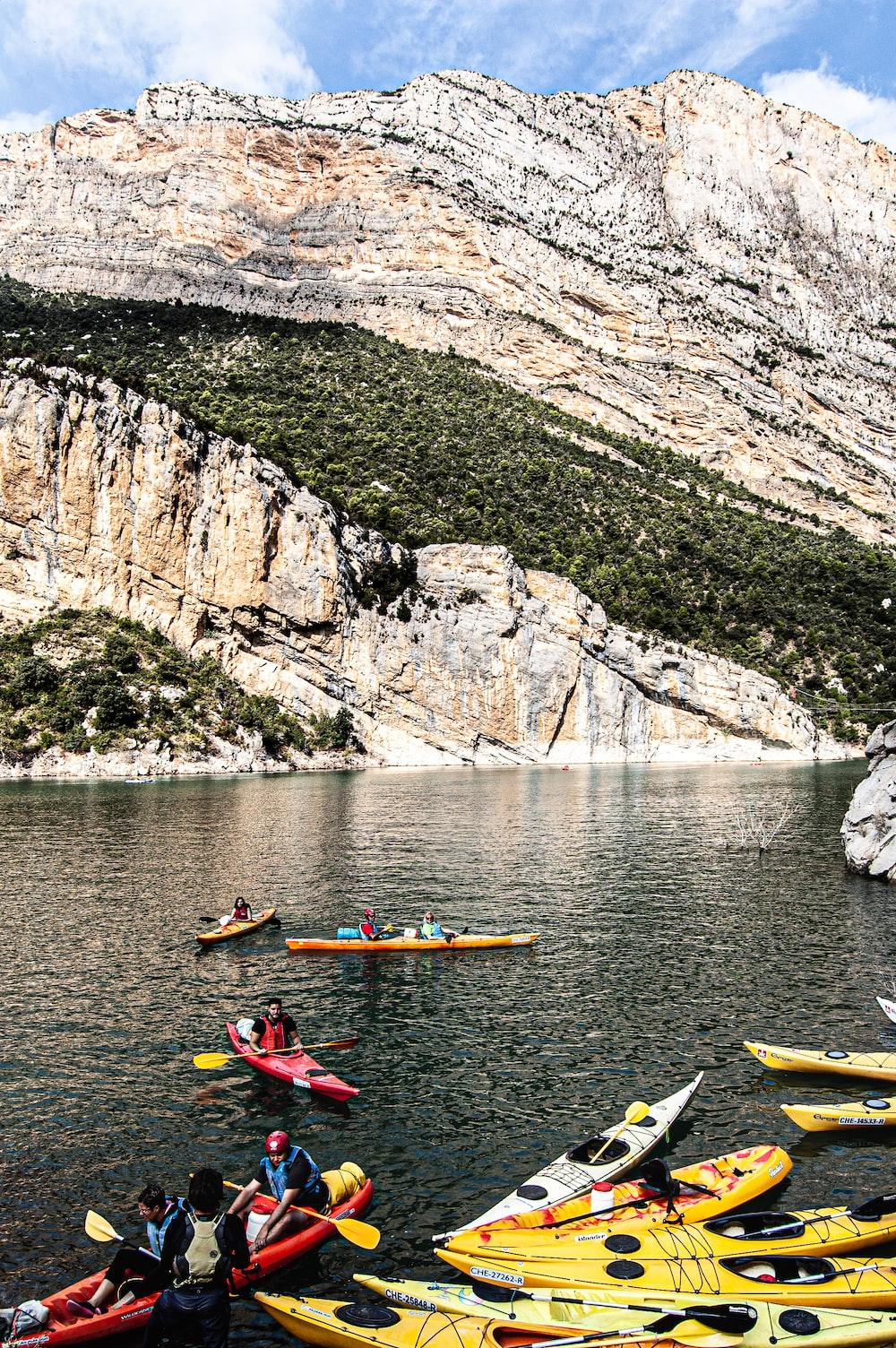 person riding on kayak on river during daytime