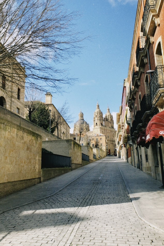 a street leading to a cathedral in Salamanca, Spain