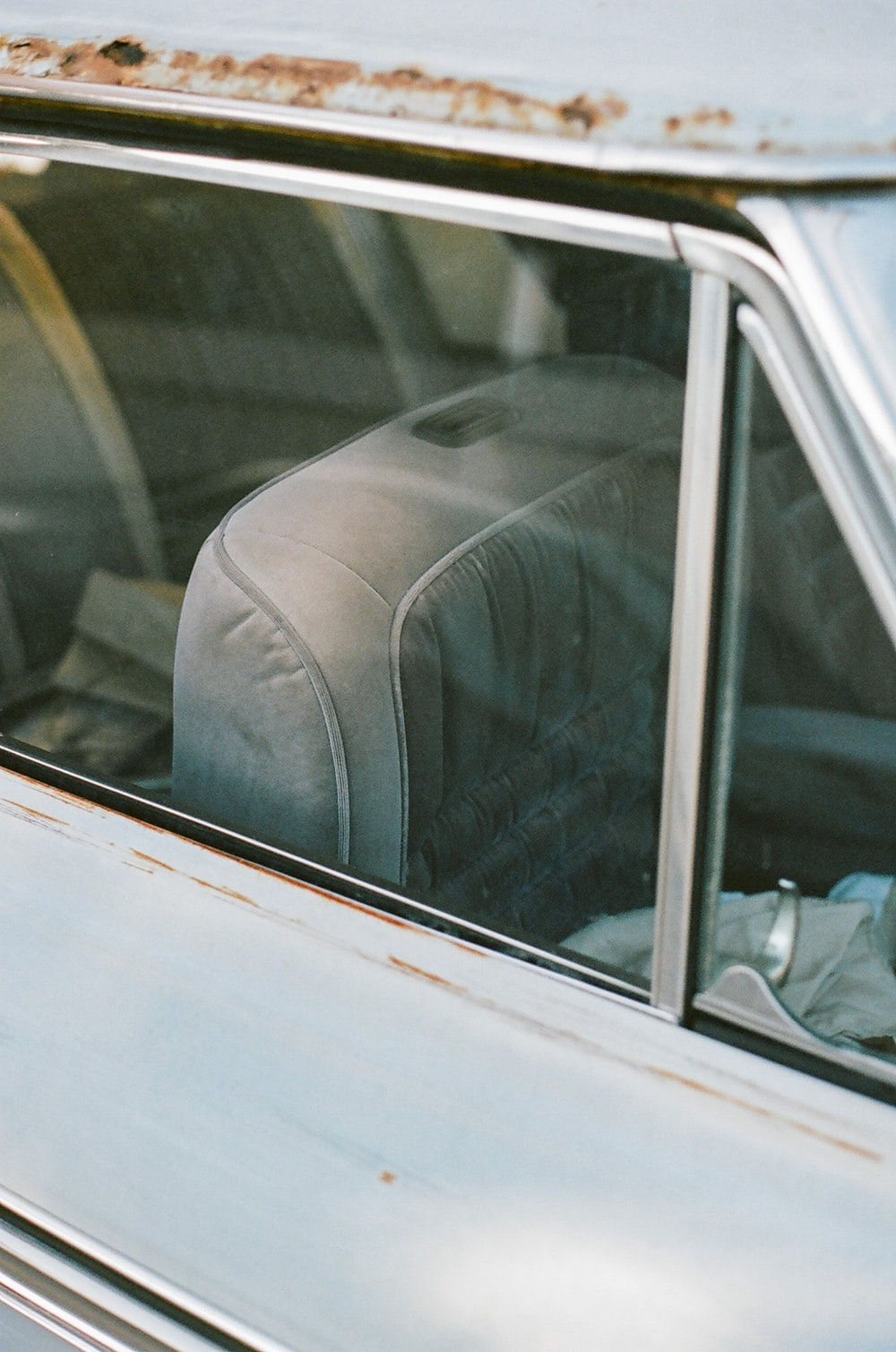 person in gray pants sitting inside car