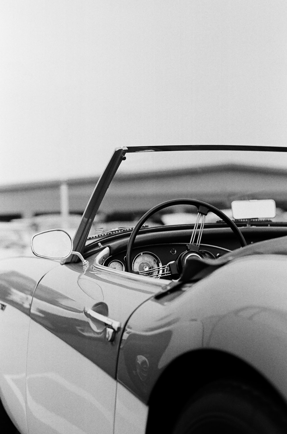 grayscale photo of classic car