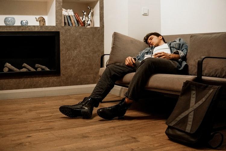man asleep on couch